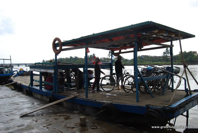 Taking the ferry with bikes across to the small island.