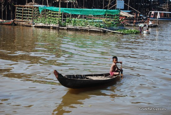 A boy moving around the floating village.