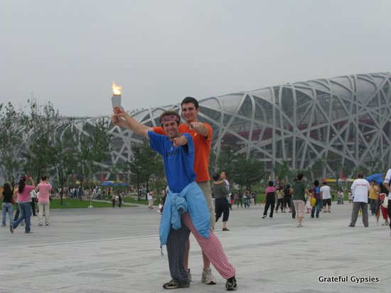 Holding up the Olympic Torch in Beijing.