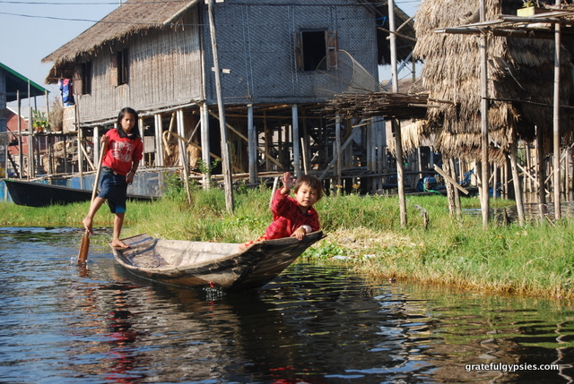 Waving at kids on Inle Lake.